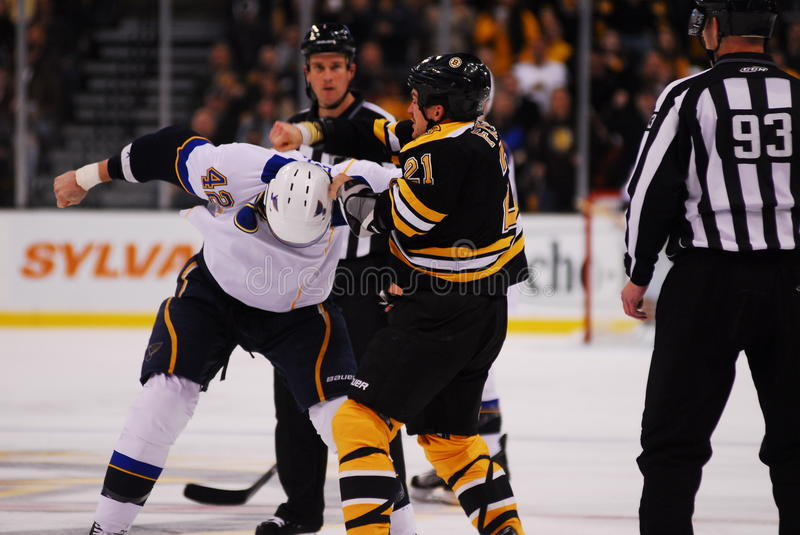 Ference and Backes battle. Bruins defenseman Andrew Ference swings over Blues winger David Backes in a fight they had Saturday, November 6, 2010 royalty free stock photos
