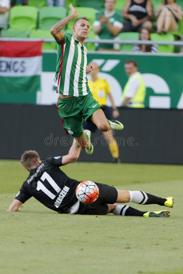 Ferencvaros vs. DVTK OTP Bank League football match. BUDAPEST, HUNGARY - JULY 26, 2015: Roland Varga of Ferencvaros flies after a sliding tackle during stock photo