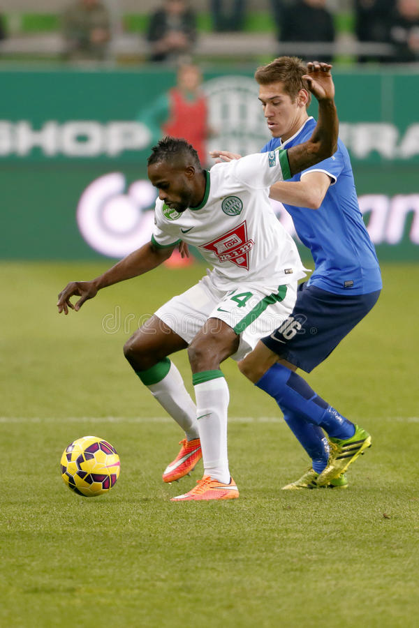 Ferencvaros vs. MTK OTP Bank League football match. BUDAPEST, HUNGARY - MARCH 22, 2015: Roland Lamah of Ferencvaros (l) covers the ball from Zsolt Poloskei of stock images