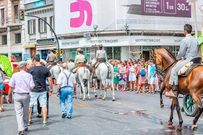 Feria de Malaga. Horse parade on the streets of Malaga. Malaga, Spain - August 11, 2012: Feria de Malaga is an annual event that takes place in mid-August and stock photos
