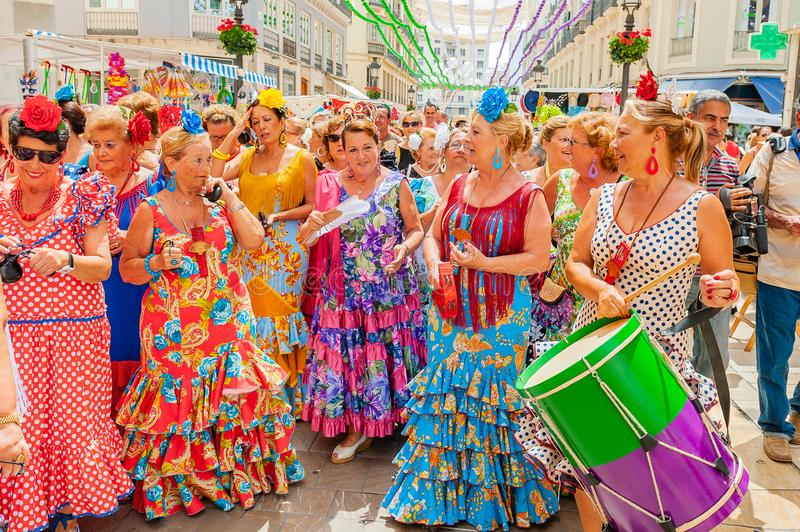 Feria de Malaga. Parade of musicians. Malaga, Spain - August 11, 2012: Feria de Malaga is an annual event that takes place in mid-August and is one of the royalty free stock photography