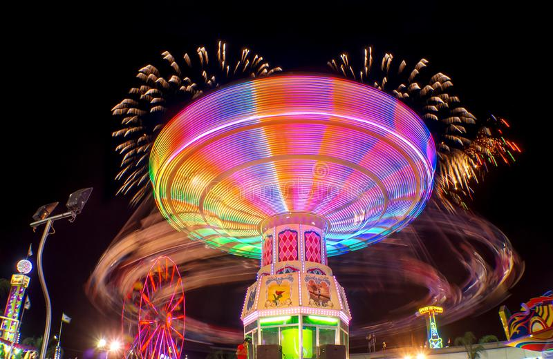 Feria juegos mecanicos light trail rides night long exposure fireworks royalty free stock photos