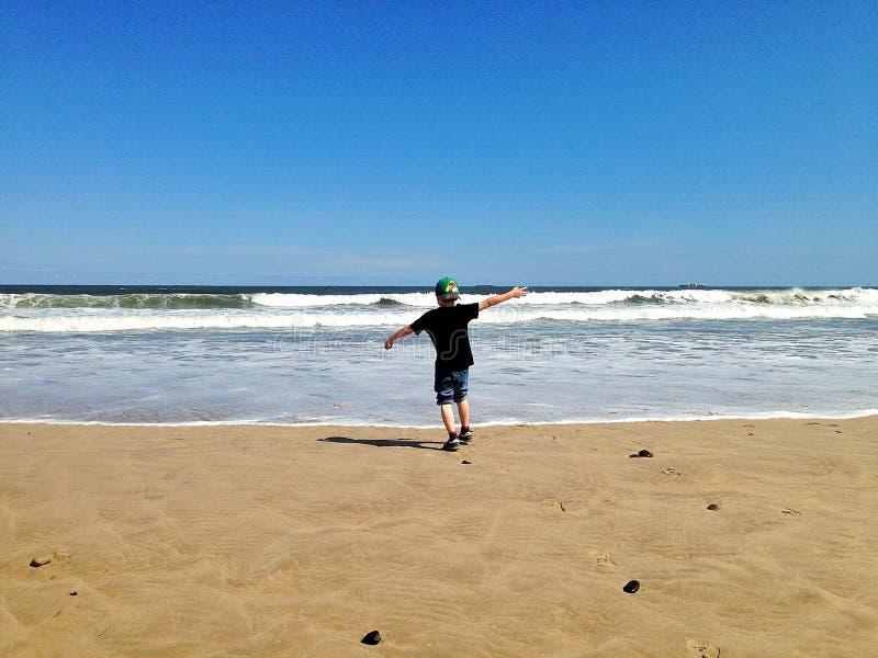 Feriado da família na praia fotografia de stock royalty free