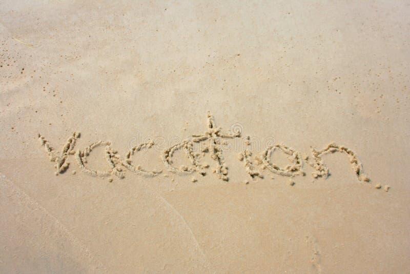 Ferien im Sand stockbild