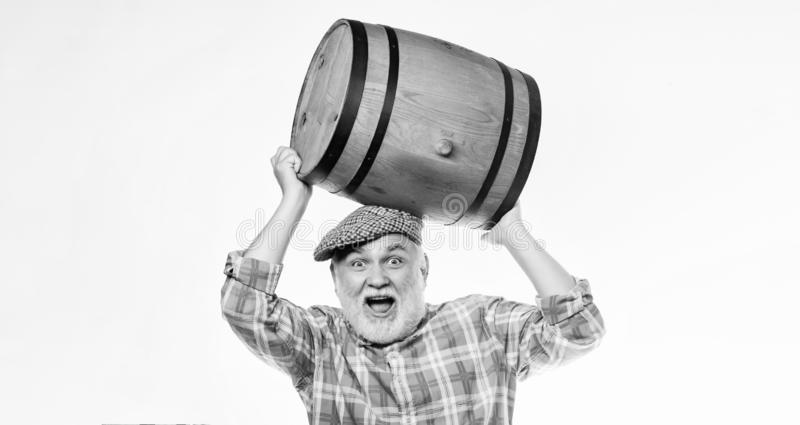 Fermentation product. Retro man with a beer barrel. Barman. wooden barrel. oktoberfest festival. brewery for maturing. Alcohol. Homemade wine. Man bearded stock images