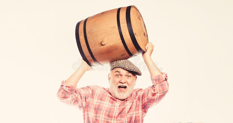 Fermentation product. Retro man with a beer barrel. Barman. wooden barrel. oktoberfest festival. brewery for maturing. Alcohol. Homemade wine. Man bearded stock image