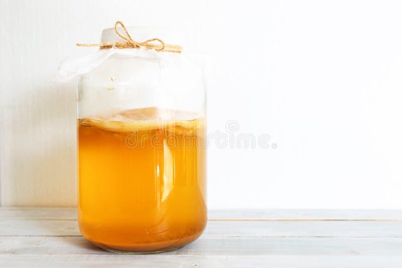 Fermented drink bottle of jun tea. Fermented beverages bottle of jun tea healthy natural probiotic made form green tea and honey stock photos