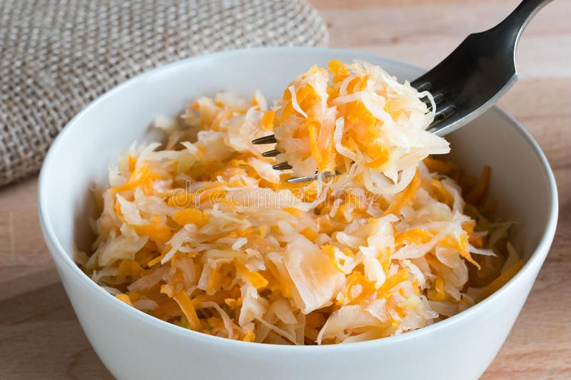 Fermented cabbage and carrots in a bowl royalty free stock photos