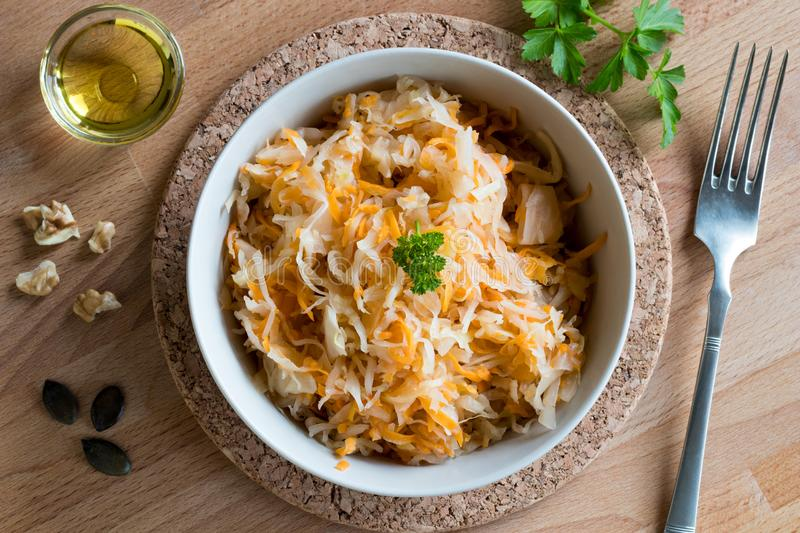 Fermented cabbage and carrots in a bowl, top view stock photos