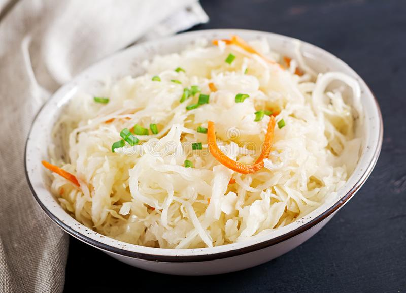 Fermented cabbage. Vegan food. Sauerkraut with carrot and spices stock photos