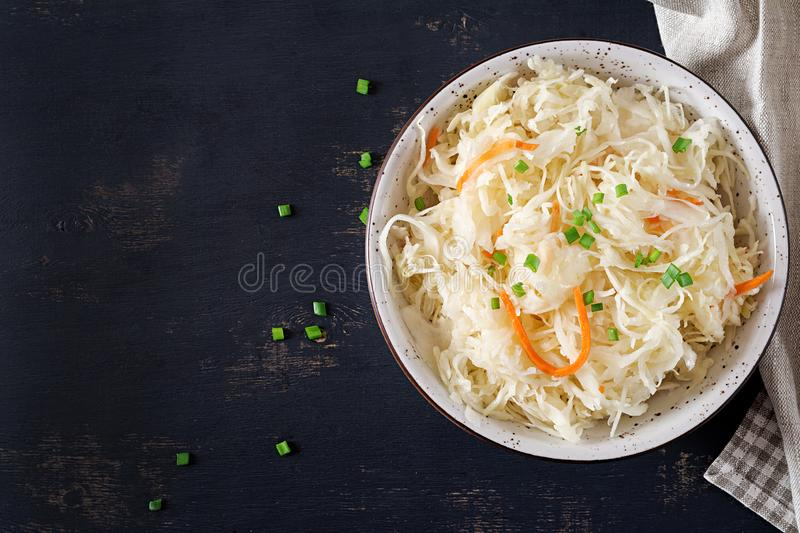 Fermented cabbage. Vegan food. Sauerkraut with carrot and spices in bowl stock images