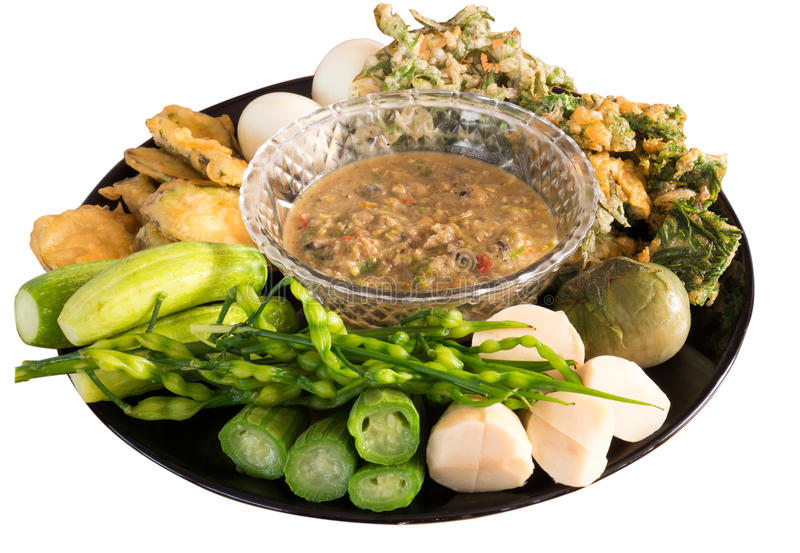 Fermented fish spicy dip with boiled eggs and vegetables stock image