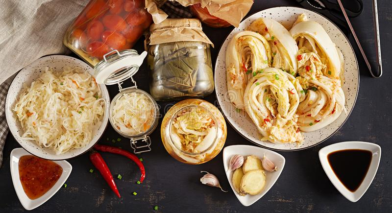Fermented food. Vegetarian food concept. Cabbage kimchi, tomatoes marinated, sauerkraut stock images