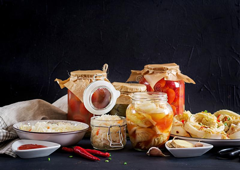 Fermented food. Vegetarian food concept. Cabbage kimchi, tomatoes marinated, sauerkraut royalty free stock photos