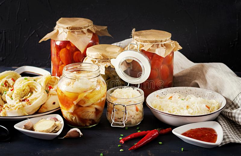 Fermented food. Vegetarian food concept. Cabbage kimchi, tomatoes marinated, sauerkraut stock photo