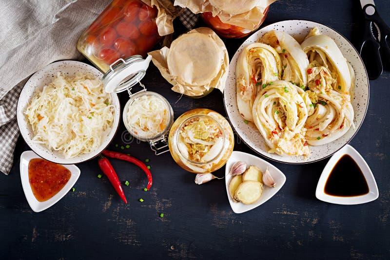 Fermented food. Vegetarian food concept. Cabbage kimchi, tomatoes marinated, sauerkraut stock photos