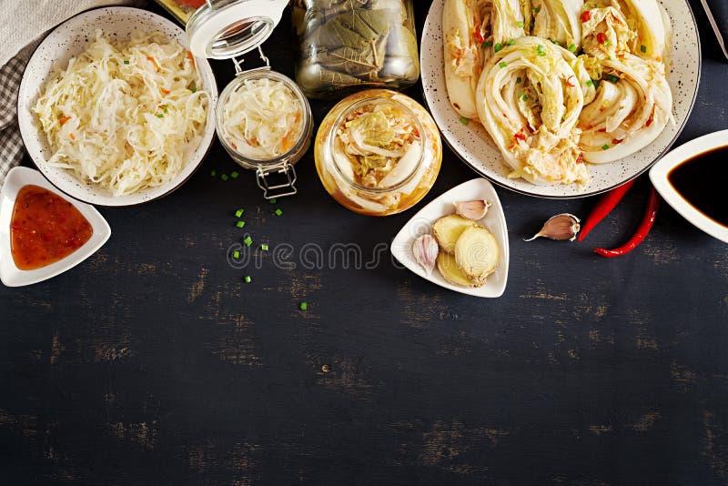 Fermented food. Vegetarian food concept. Cabbage kimchi, tomatoes marinated, sauerkraut stock image