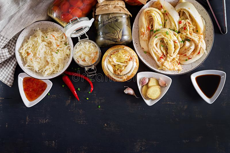 Fermented food. Vegetarian food concept. Cabbage kimchi, tomatoes marinated, sauerkraut royalty free stock images