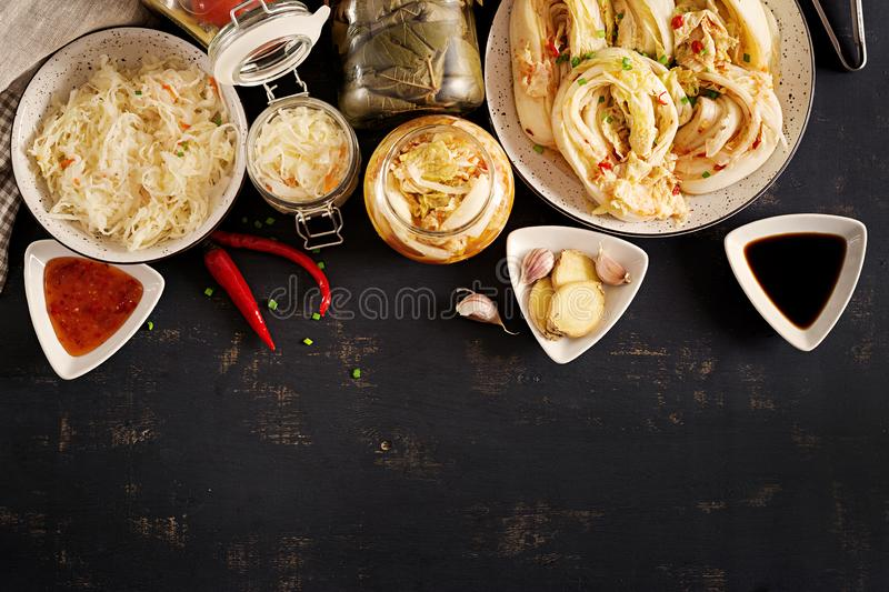 Fermented food. Vegetarian food concept. Cabbage kimchi, tomatoes marinated, sauerkraut royalty free stock image