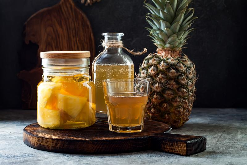 Fermented mexican pineapple Tepache. Homemade raw kombucha tea with pineapple. Healthy natural probiotic flavored drink. Copy space stock photos