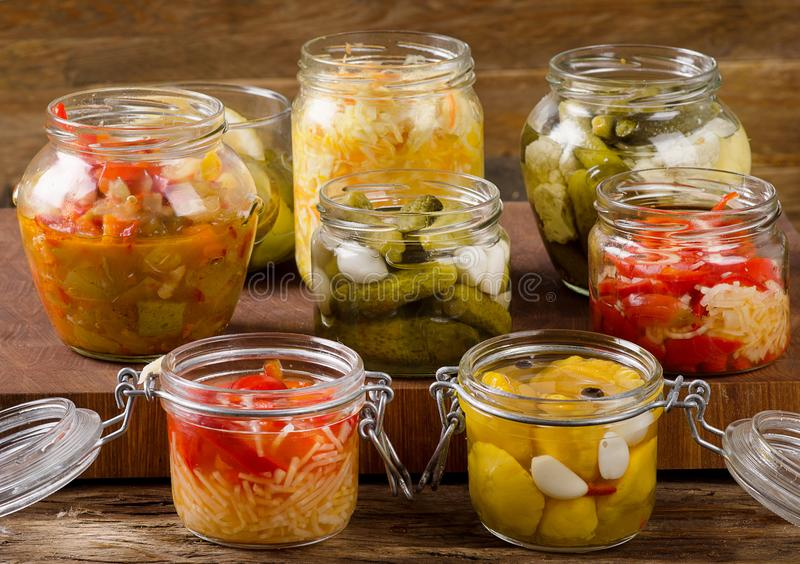 Fermented vegetables. On a dark rustic background royalty free stock photography