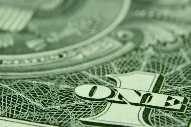 Fermez-vous d'UN et de 1 d'un billet d'un dollar américain images libres de droits