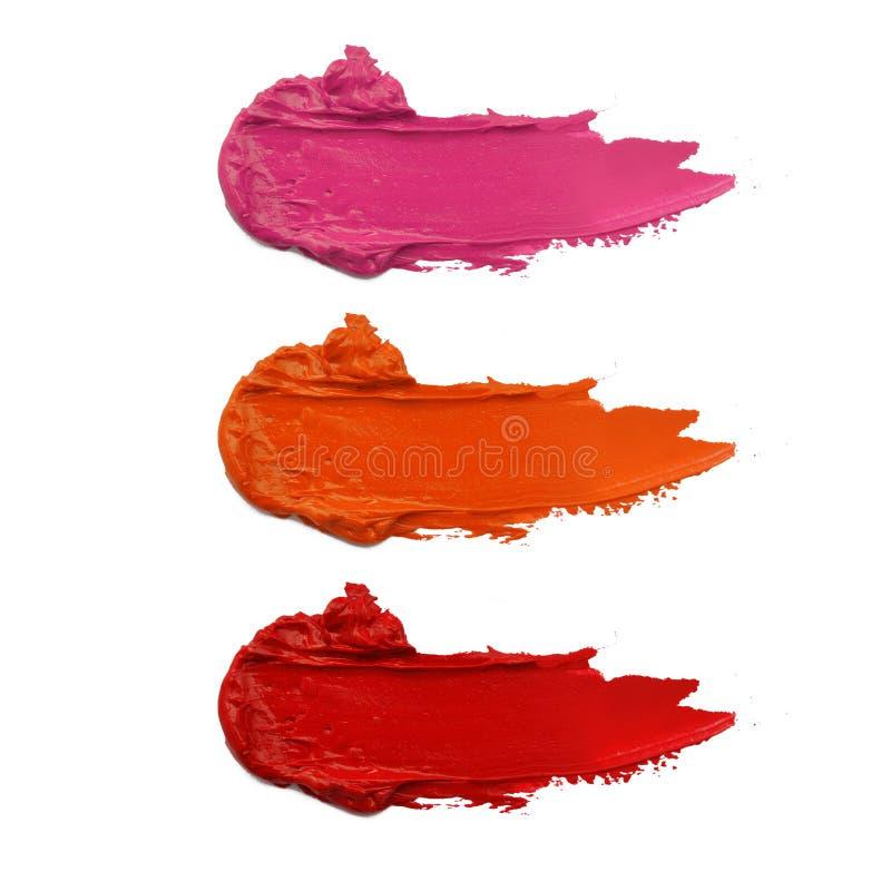 Fermez-vous d'un rouge à lèvres taché photo libre de droits