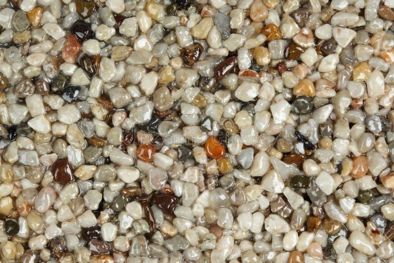 Fermez-vous d'un tapis en pierre naturel photos stock