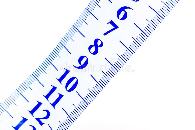 Fermez-vous d'une bande pour mesurer photo libre de droits