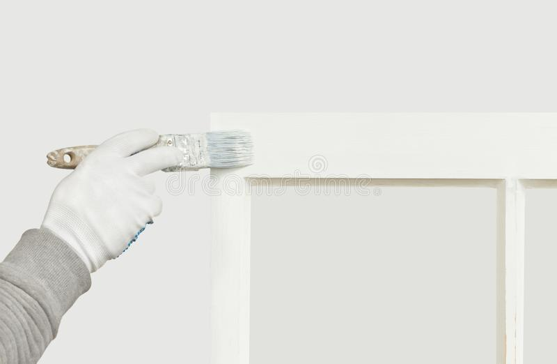Fermez-vous d'une fenêtre de ceinture de peinture de personne images stock