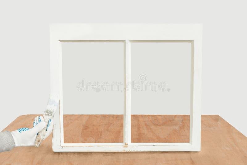 Fermez-vous d'une fenêtre de ceinture reconstituée par peinture de personne image stock