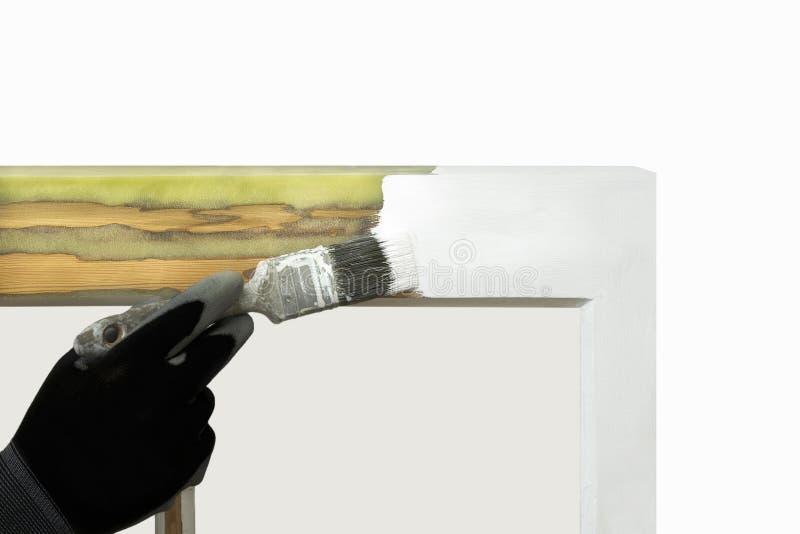 Fermez-vous d'une personne que la peinture a reconstitué des fenêtres de ceinture photo libre de droits