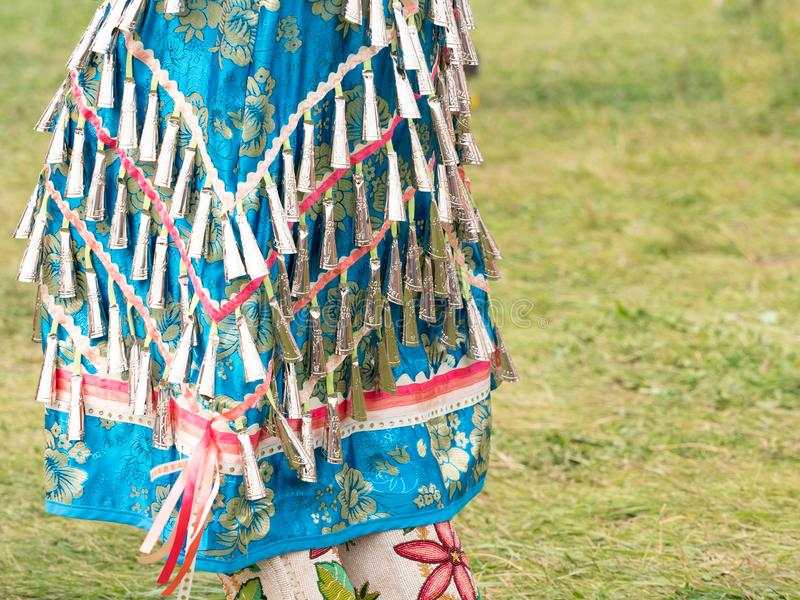 Fermez-vous de Jingle Bead Brocade Dress et d'un Mocassins perlé image libre de droits