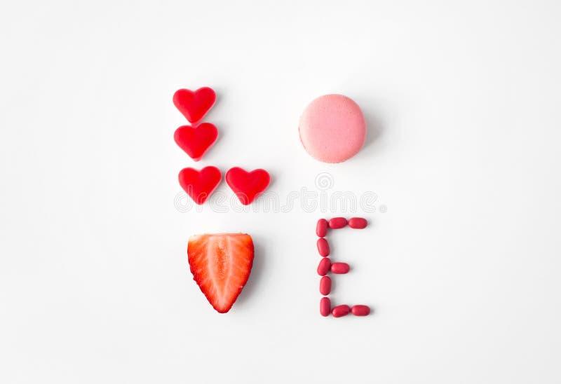 Fermez-vous de l'amour de mot fait de bonbons image libre de droits
