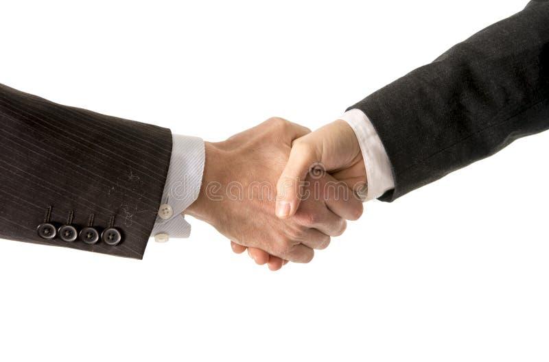 Fermez-vous de l'homme d'affaires serrant la main avec la femme d'affaires photos libres de droits