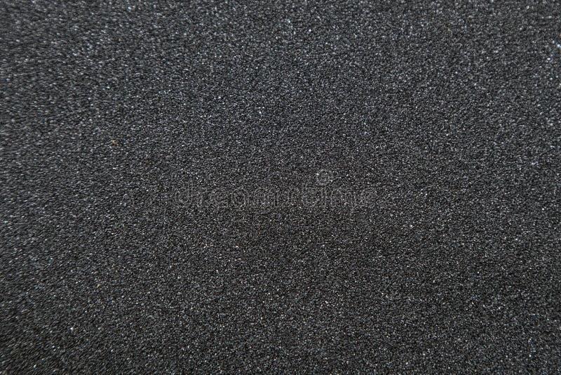 Fermez-vous de la bande de poignée de planche à roulettes Macro photographie de sandpap photo stock