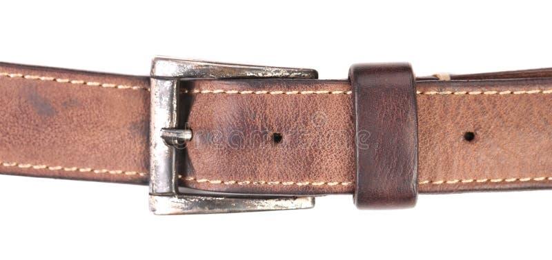 Fermez-vous de la ceinture en cuir brune. photo libre de droits