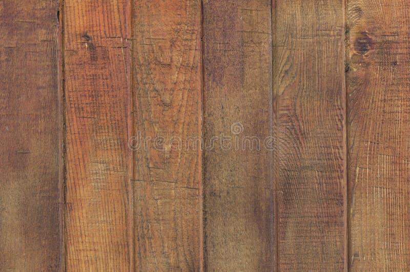 Fermez-vous de la clôture du bois brune propre image stock