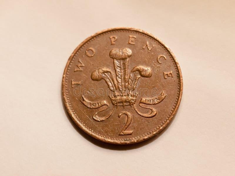 Fermez-vous de la devise brune du R-U de pièce de monnaie de penny de l'anglais deux photo libre de droits