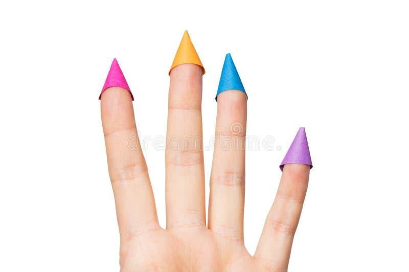 Fermez-vous de la main avec quatre doigts dans des chapeaux de partie images stock