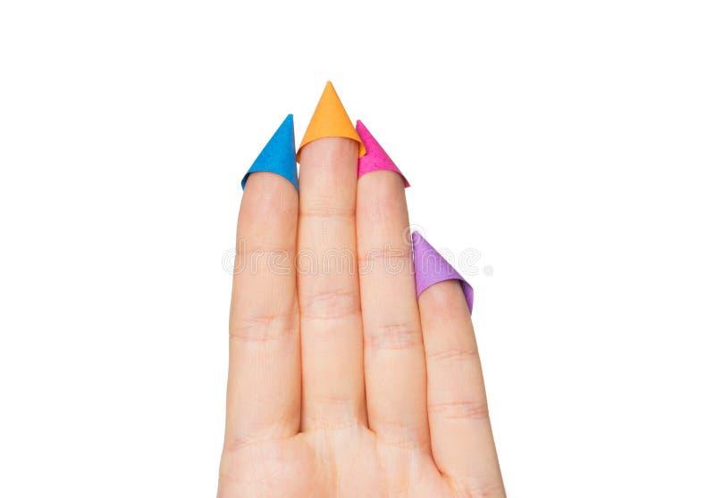 Fermez-vous de la main avec quatre doigts dans des chapeaux de partie photos libres de droits