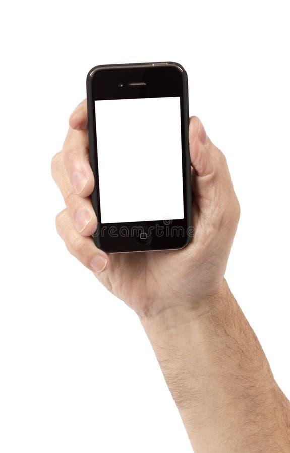 Fermez-vous de la main jugeant le téléphone intelligent d'isolement sur le blanc image libre de droits