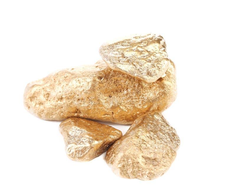 Fermez-vous de la pépite d'or. image libre de droits