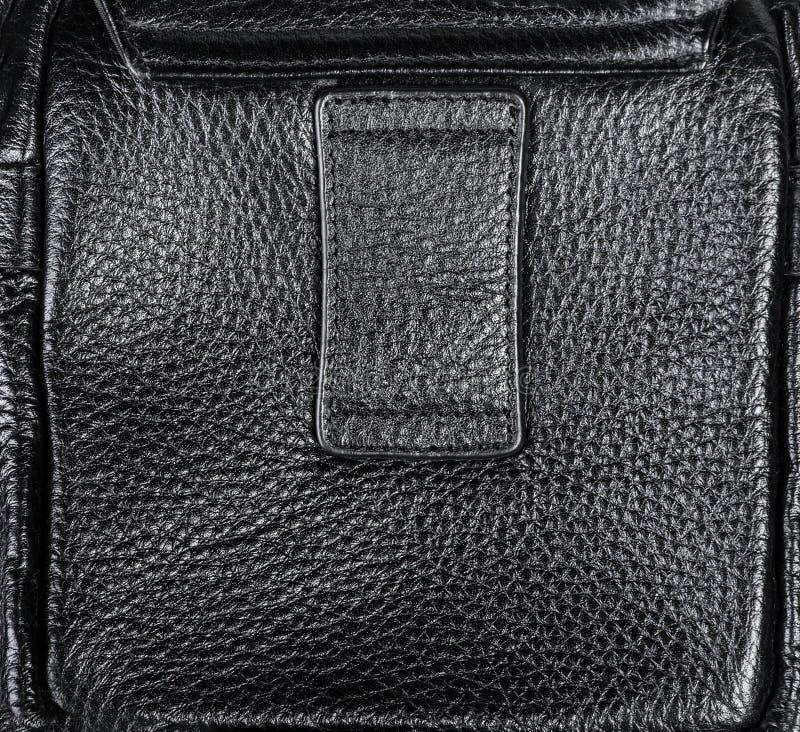 Fermez-vous de la texture en cuir noire photographie stock libre de droits