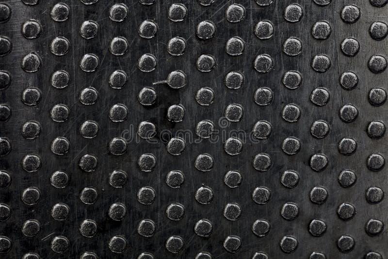 Fermez-vous de la texture en métal avec des prépondérances rondes images libres de droits