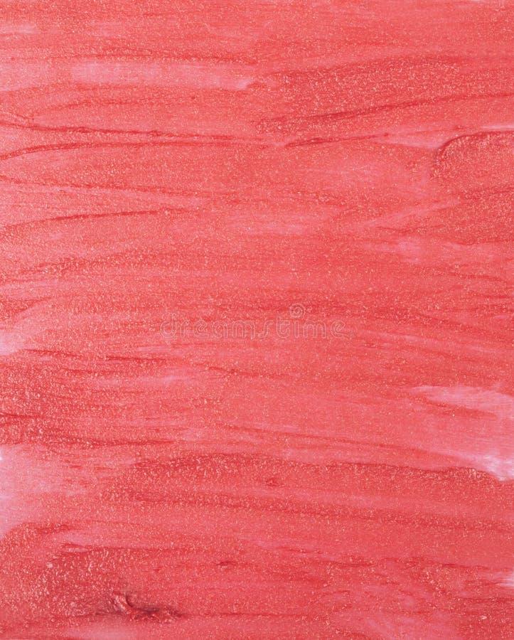 Fermez-vous de la texture rouge de rouge à lèvres photographie stock