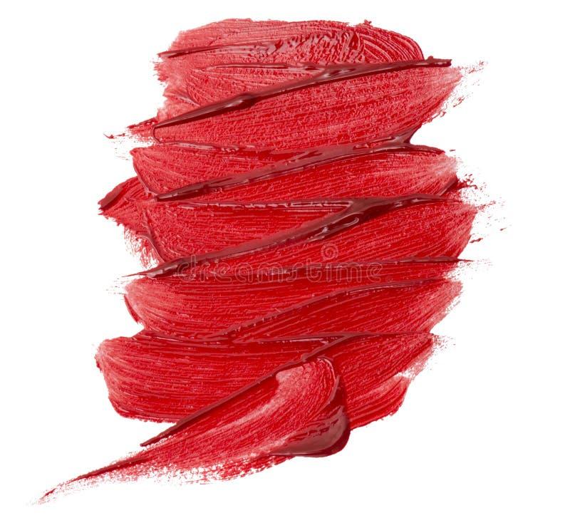 Fermez-vous de la texture rouge de rouge à lèvres d'isolement images libres de droits