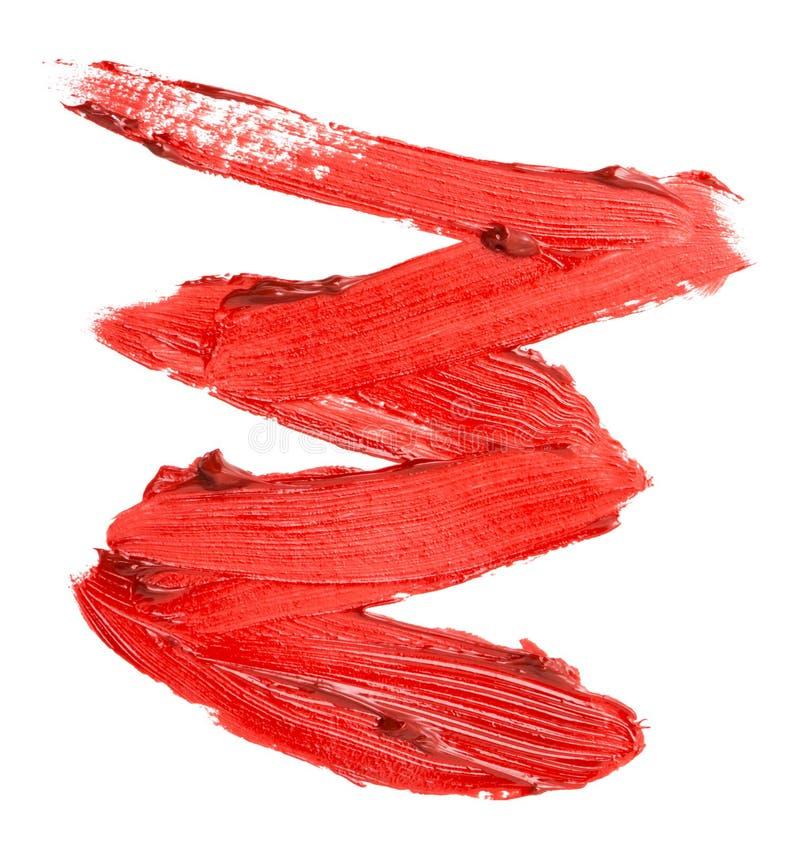Fermez-vous de la texture rouge de rouge à lèvres d'isolement image stock