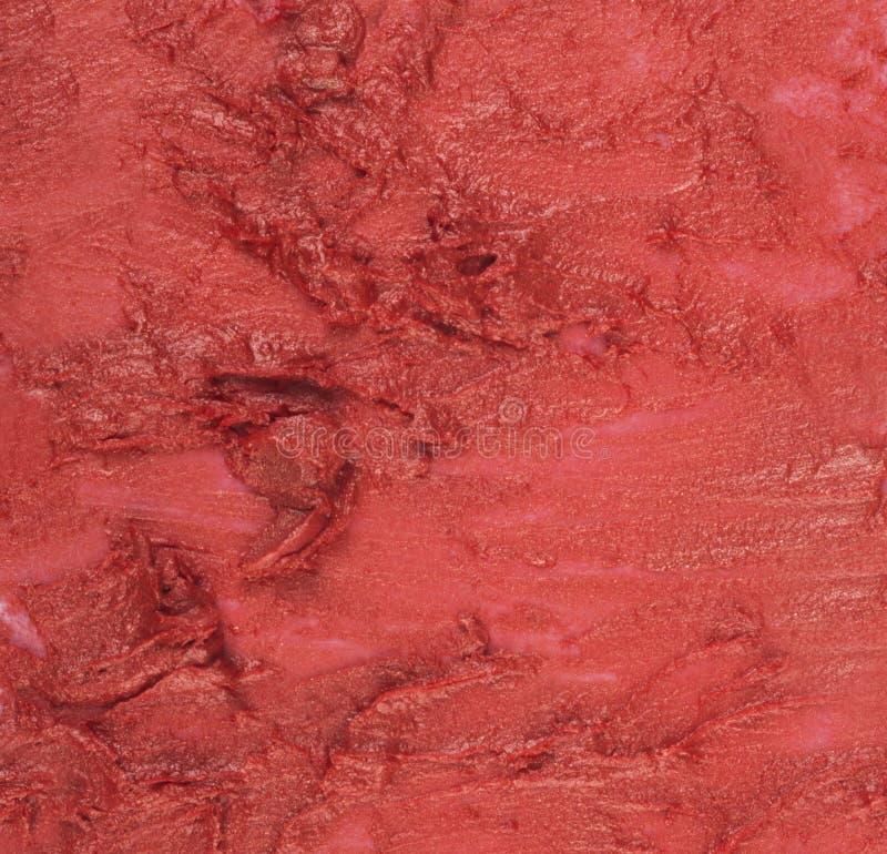 Fermez-vous de la texture rouge de rouge à lèvres Peut être employé comme fond images libres de droits