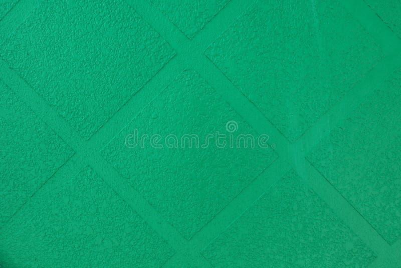 Fermez-vous de la texture verte de mur pour le fond image stock